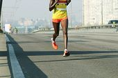Young Woman Running On City Bridge Road. Marathon Running In The Morning Light . Running On City Roa poster