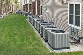 Heating And Air Conditioning Units Used To Heat And Cool An Apartment Complex poster