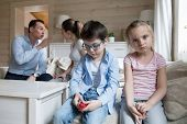 Sad Children Listen Parents Have Angry Fight At Home Headshot poster