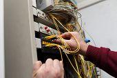 Technician Attaching Optical Connector