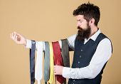 Which One Is Matching His Clothing Style. Bearded Man Choosing The Right Necktie For Business Life S poster