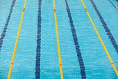 Clear Transparent Swimming Pool Water.  Swim Lanes In Olympic Swimming Pool poster
