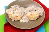stock photo of biscuits gravy  - American Southern Style Sausage Biscuits and Gravy in Table Setting - JPG