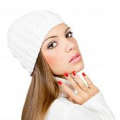 Gorgeous young woman in white winter clothes isolated on white