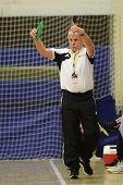 SIOFOK, HUNGARY - NOVEMBER 17: Szilard Kiss (Siofok trainer) in action at EHF Cup handball match Siofok (black) (HUN) vs. Astrakhanochka (purple) (RUS) November 17, 2012 in Siofok, Hungary.
