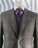pic of v-neck collar  - Close up of a grey checkered jacket with blue v - JPG