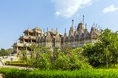 stock photo of jainism  - FAMOUS Jain Temple in Ranakpur under blue sky, the holy place for the Jain
