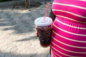 Asian Pregnant Woman Holding A Cup Of Softdrink