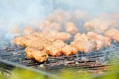 spicy force-meat balls on the grill
