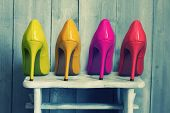 stock photo of foot  - Retro photo of pink yellow and red shoes - JPG