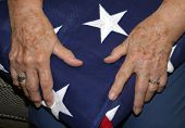 Widow holds Veteran's Flag