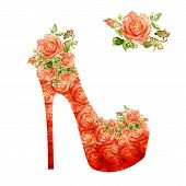 Shoes on a high heel decorated with roses.