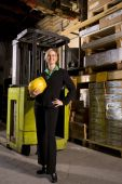 Female businesswoman standing in storage warehouse