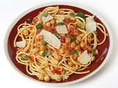 Spaghetti with a chickpea, tomato and chilli flakes sauce, garnished with fresh torn basil leaves and flakes of parmesan. This is a traditional Italian dish,called spaghetti alla ceci