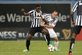 LOS ANGELES - AUGUST 3: Galaxy M Landon Donovan & Juventus M Kwadwo Asamoah during the 2013 GICC gam