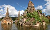 stock photo of shan  - Ancient flooded pagodas in ruins near Samkar village on Inle lake - JPG