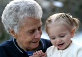 picture of nana  - Sweet old woman shares a laugh with little child - JPG