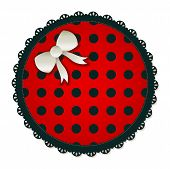 Illustration of a red & black circle textile patch. Accented with a small white bow.
