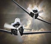 Dramatic scene on the sky. Vintage fighter planes inbound from sun. Retro technology background.