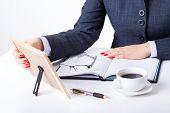Sentimental Businesswoman By Her Desk
