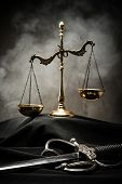 picture of mantle  - Scales and sword of Justice on a judge - JPG