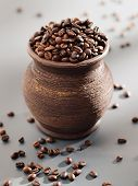 Old Grungy Pot Full Of Roasted Coffee Beans.
