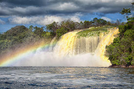 picture of canaima  - powerful waterfall and a rainbow in front shot in canaima - JPG