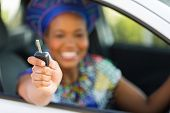 african zulu woman showing car key inside new vehicle