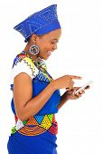 gorgeous black woman using smart phone on white background
