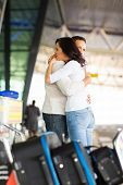 stock photo of goodbye  - sad young couple say goodbye at airport - JPG