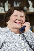Laughing Elderly Woman Calling By Phone