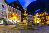 HALLSTATT, AUSTRIA - 20 JUNE 2014: Streets of Hallstatt at dusk, Austria. Hallstatt is historical village located in Austrian Alps at the Hallstatter lake and promoted by UNESCO World Heritage region.