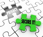 Privacy and Secure It words on 3d puzzle pieces illustrate importance of locking and security of pri