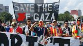 Kuala Lumpur, Malaysia - August, 2: Group of people hold sign protesting Israeli military strikes on
