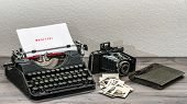 Retro Typewriter And Vintage Photo Camera