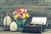 stock photo of easter lily  - Easter decoration with tulips eggs and antique typewriter - JPG
