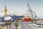 Ras Tanura, Saudi Arabia - May 13, 2014: Port View With Moored Ships And Workers, Saudi Arabia