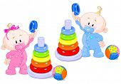 pic of cylinder pyramid  - The toddler boy and girl play developing color pyramid - JPG