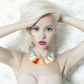 Fashion art photo of beautiful lady doll with blue eyes
