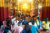 Peoples Praying Maha Muni Buddha.