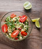 pic of tabouleh  - Tabbouleh with couscous and parsley healthy salad in glass bowl on wooden table - JPG
