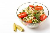 pic of tabouleh  - Tabbouleh with couscous and parsley healthy salad in glass bowl on white background - JPG