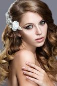 Beautiful girl in wedding image with flowers in her hair