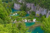 Plitvice Lakes: People Walking On A Footbridge Over Water