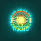 stock photo of asoka  - Asoka Wheel in national tricolors with stylish text India on green background for Indian Independence Day celebrations - JPG