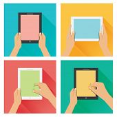 Hand on tablet flat