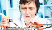 electronic factory women worker to solder electronic device