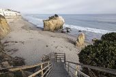 Public access stairs leading down to hidden cove on Malibu's affluent northern shore.