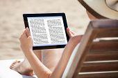 Woman Reading Ebook On Beach Chair
