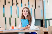 image of canteen  - Girl studying in the University canteen with Fresh and cake - JPG